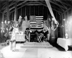 (Interior of tent building with podium, piano, and banners.) Barley (74)