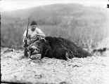 [Kenneth Chisholm and dead bear.]