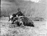 [Ed Levin with dead bear and dog.]