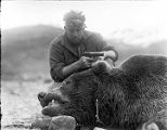 [Ed Levin with handgun and dead bear, close up.]