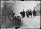 [Group of school children standing on path carved through deep snow.  Another group of children...