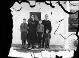 [Axelson family in front of the Mission House.]