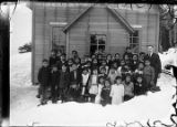 [Group portrait of school children outside the school which became a church.]