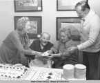 "Governor Parks and friends behind cake decorated with ""Happy Birthday George Parks""."