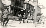 [Juneau, Alaska.  Fourth of July parade? Uniformed soldiers holding rifles marching up street, 2nd...