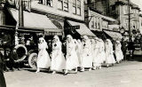 [4th of July parade? Red Cross nurses marching down street in front of the Seward Bldg., Juneau.]