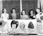Martha, Sarah Jane, Dora[Sweeney], Vide [Bartlett], and Esther pose with their sketched portraits.