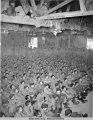 USO show at warehouse #10 (for Army) - view of spectators from above, May 3, 1943.