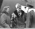 USO Camp Shows - Martha O'Driscoll & Errol Flynn chatting with Comdr. Conn, Dec. 4, 1943.