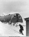 Figure and quonset hut in snow, 10 Dec. 1942.