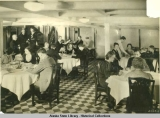 Dining Room scene with passengers.