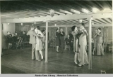 Passengers dancing on board steamship.
