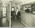 Crew in bar aboard steamship.