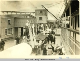 Dock scene at Juneau, showing a part of the Juneau Cold Storage,  Dec. 1931.