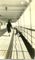 Woman walking on the deck of a steamship. Woman walking on the deck of a steamship.