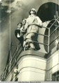 View of three passengers leaning on railing aboard steamship.