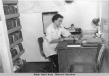 Dr. Hazel Blair, physician in charge of M/V HEALTH, works on records while boat travels to next...