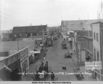Looking up Front St., Nome, Alaska, from N.W. Commercial Co's Bridge.