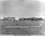 Rear of Eskimo Camp, Nome, Alaska.  Showing upturned Skin Boats. 1905.