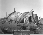 A miner's home on Nome Beach.  Joseph Shaw age 73 yrs.