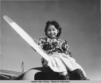 Girl sitting on an airplane.