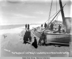 The GREYHOUND and MARY C. crushed by ice on Nome beach.  Jan 4, 1907.