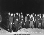Flashlight group of skaters-on Snake River, Nome, Alaska, Oct. 29, 1906, 11 PM.