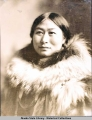 Studio portrait of an Eskimo woman dressed in fur parka.