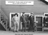 Four men outside U.S. Navy Fueling Station, Akutan Alaska.