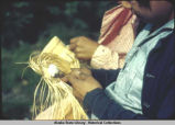 Weaving Attu baskets, M.G. 7/41.