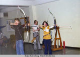 Archery. Two archers aim bows.