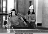 Table tennis. Two players, side-by-side focus on table tennis ball.
