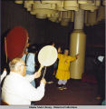 Exhibits/Entertainment at Wood Center. Men play traditional drums. A woman dances in kuspuk and...
