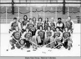 Hockey. Women's team pose on ice in uniform.