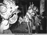 Opening ceremony. Two people in elaborate fish costumes.