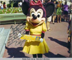 Minnie Mouse holding 1974 AWG bumper sticker. Signed color photo.