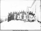 Children in costume for the school play standing outside of school next to ANB Hall, ca. 1928.
