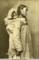 Studio portrait of Native woman carrying sleeping child on back, 1903.