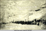Scene of snowslide on the Dyea trail, 1898. Searching for the bodies of the victims.