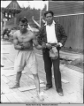 Two Filipino cannery workers; one of them in boxing outfit.
