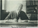 James Wickersham at his desk.
