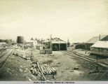 Katalla railroad yard with engine in center building.