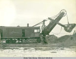 Katalla Co. no. 2 railroad car with steam shovel.