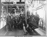 The superintendent and engineers in the cannery.