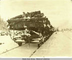 Railroad cars with load during winter. No engine in sight.