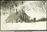 Side view of tent camp and snowshoes in winter.