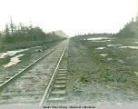 Stretch of railroad tracks.