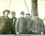 Five men on ship and Ray Moss is second from the right.