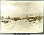 Buildings and railroad track in winter.