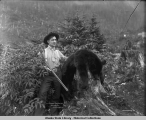 Z.R. Cheney and his game. Aug. 26 1907 Juneau, Alaska.